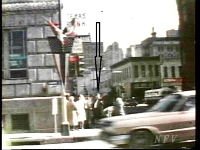 The Assassination Film-55-Muchmore film-Umbrella Man 1-Arrow points to UM